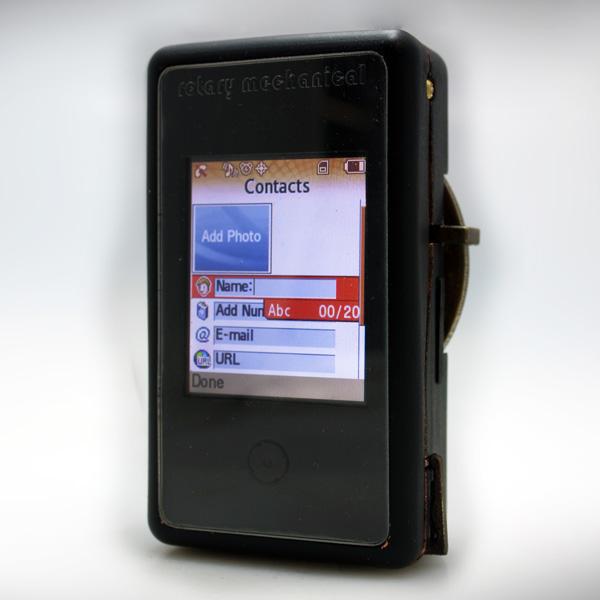[http://www.yankodesign.com/images/design_news/2011/06/16/rotary_phone7.jpg]