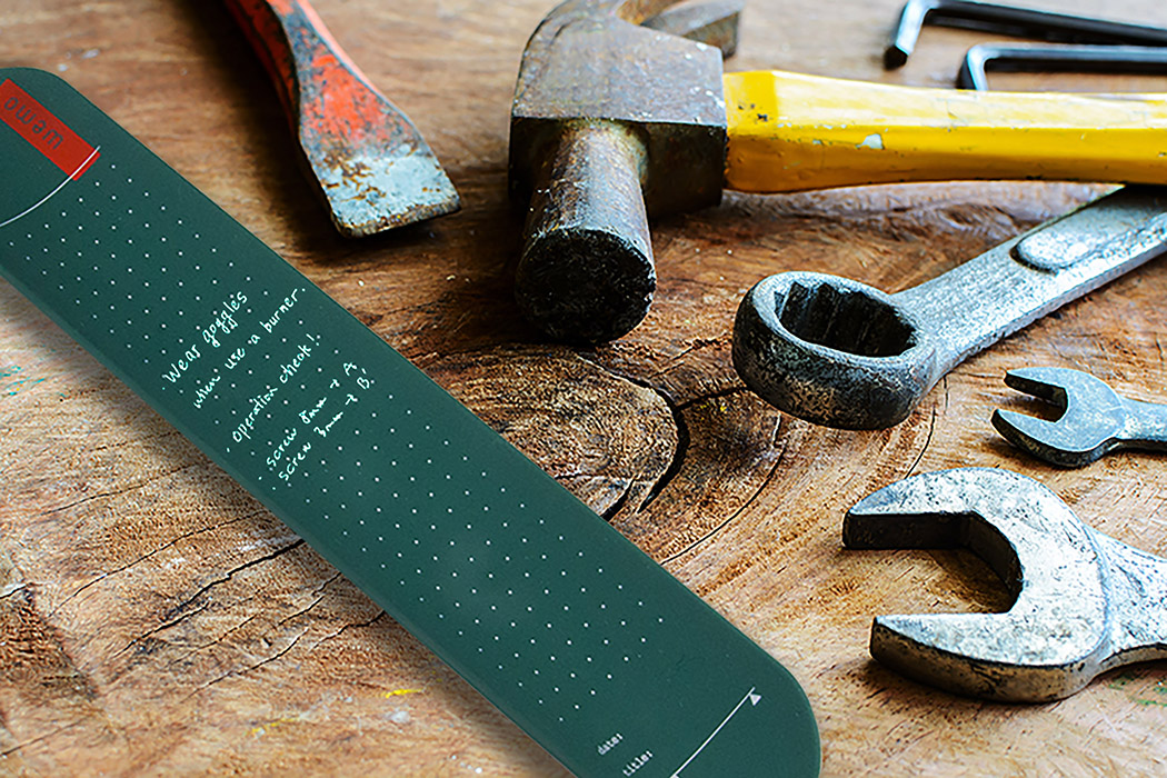 Close up of rusty hammer and tools on old grunge wood background