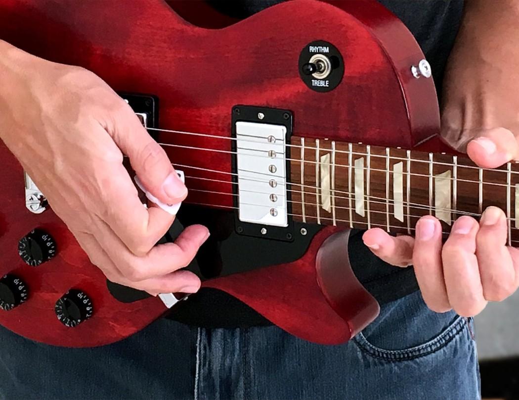 Someone built an ergonomic guitar pick