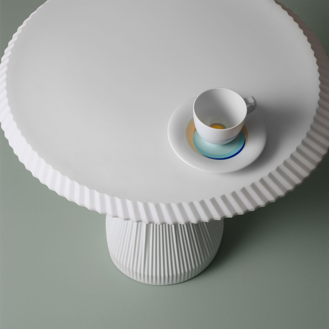 This pure porcelain side-table gives the illusion of fabric