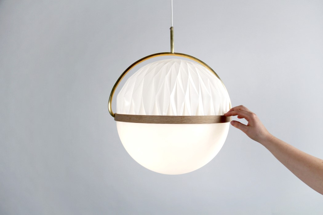 The SETTO lamp uses a rotating lampshade to adjust its lighting