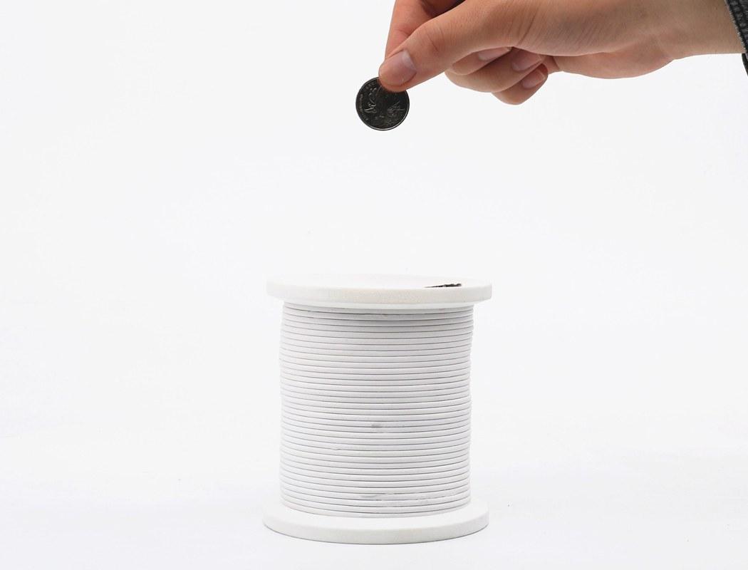Apart Design Bank.The Slinky That S A Piggy Bank Yanko Design