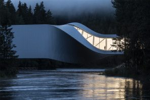 A spiraling stack of books that houses a bridge and a museum!