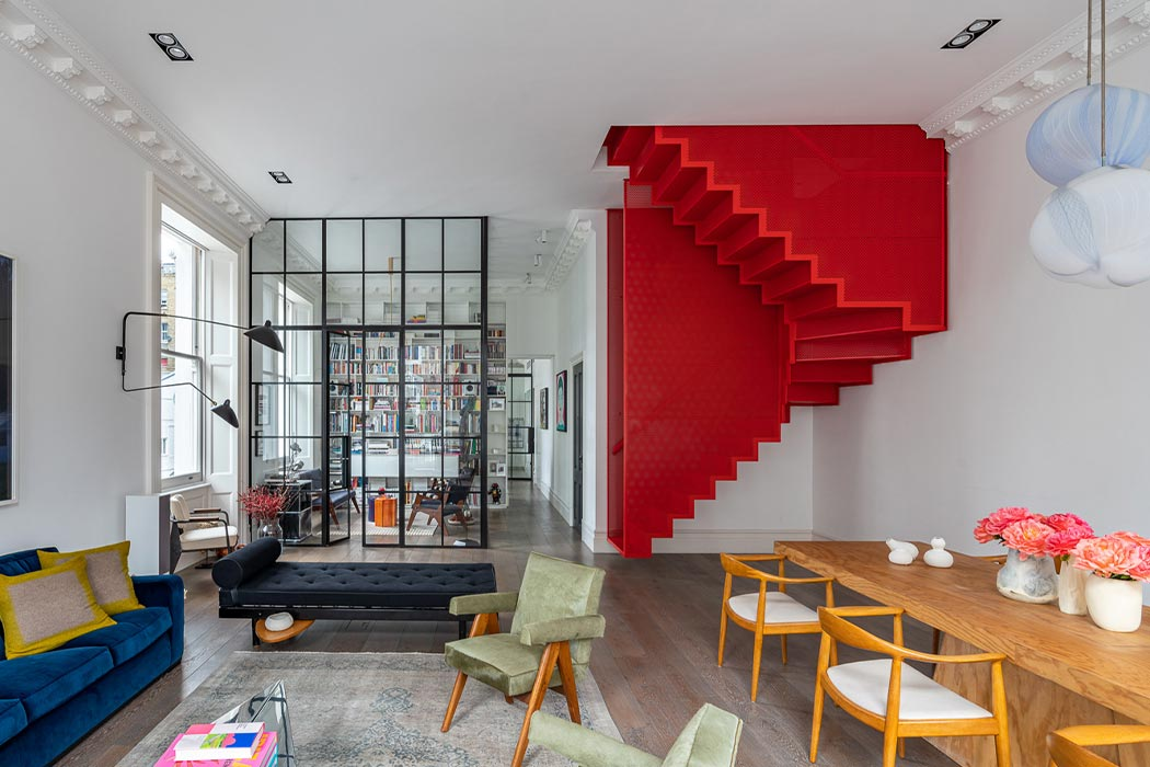 This floating red staircase brings a modern Harry Potter element to this London apartment!
