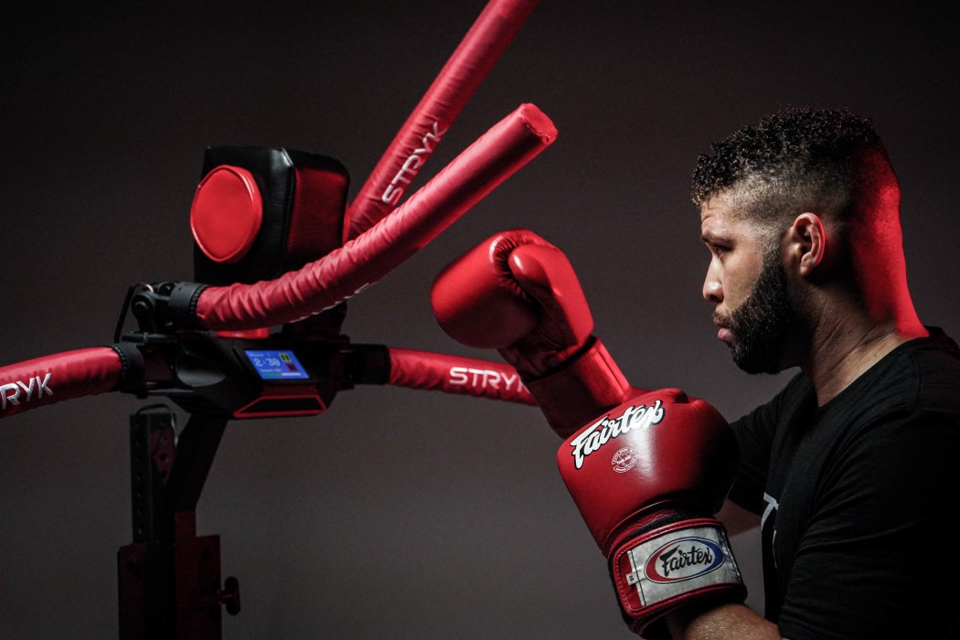 This 4-armed sparring robot throws punches back at you while you're boxing!