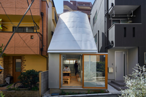 This tiny house in Tokyo boasts of a funnel-shaped roof that doubles as a skylight!