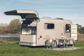 This solar camper trailer comes equipped with a full kitchen + a retractable roof for star-gazing!