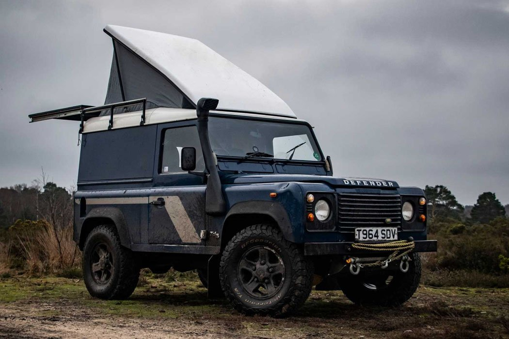This Land Rover Defender camper's pop-up roof unveils a lavish wooden cabin
