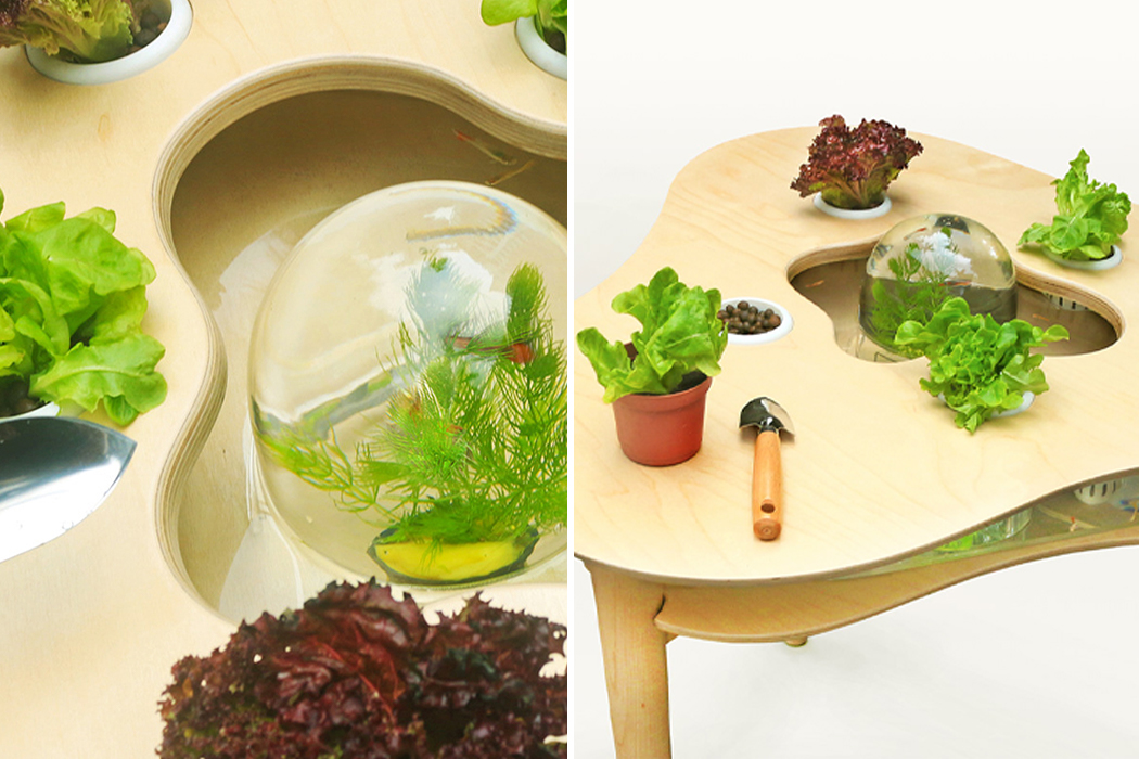 This indoor horticulture gardening table uses aquaponics to grow plants and cutout's to create a functional sculpture!
