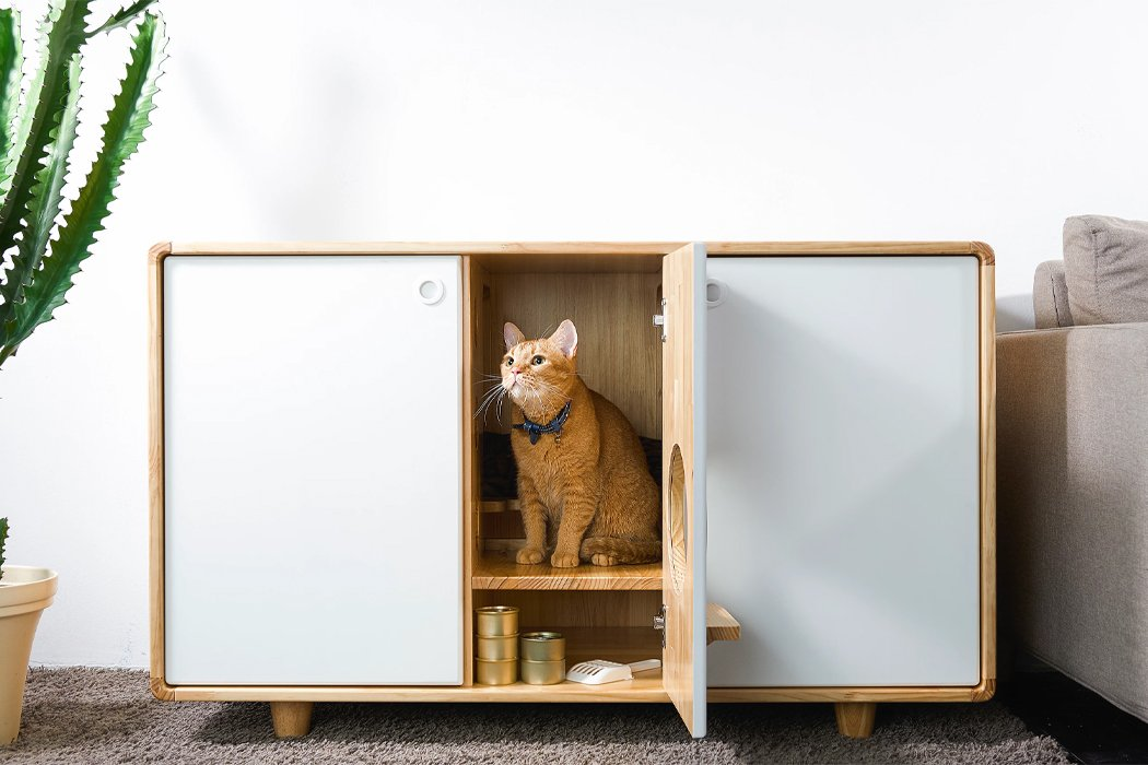 This cat kennel doubles as a cat tower and storage area with enough room for two indoor litter boxes!