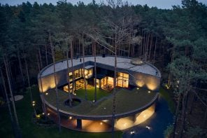 This circular house is inspired by a cut tree trunk & was made to blend into the surrounding pine forest!