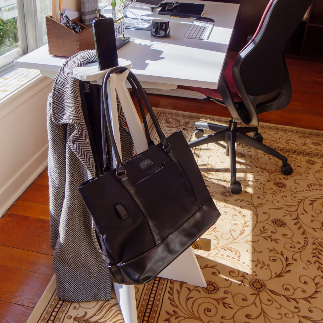Ever felt weird keeping your well-designed backpack on a dirty floor? This side-table lets you hang your bag