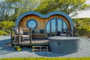 This tiny cabin looks like a minion-inspired hobbit pod for an outdoorsy glamping getaway!