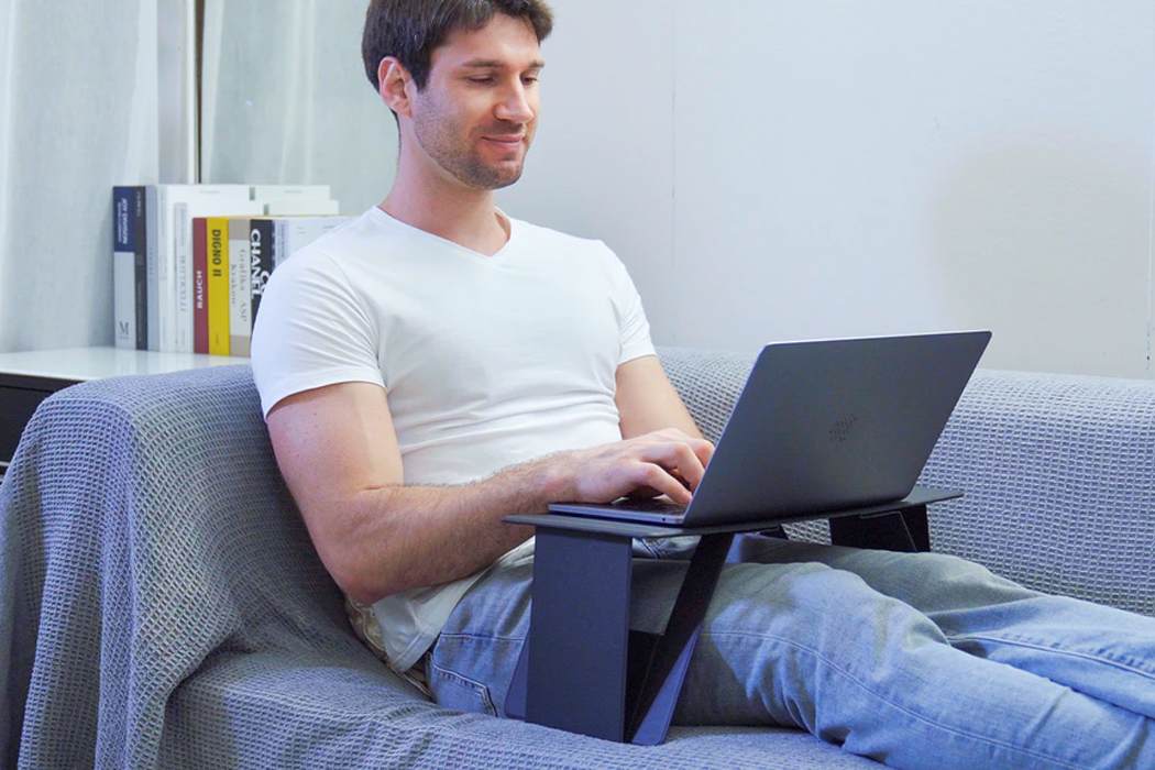 This paper-thin laptop desk comes with 6 configurations to work from your office + bed!