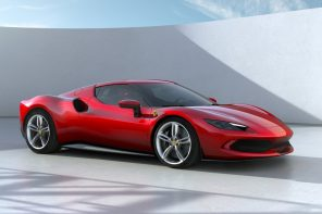No, that isn't a Tesla Roadster. It's Ferrari's new futuristic hybrid supercar!