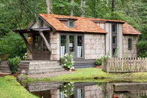 This low-country tiny cottage embraces rustic minimalism for the ideal winter escape in the marshlands!
